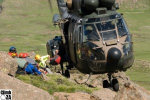 Rescuers exiting the precariously perched Oryx helicopter during an exercise