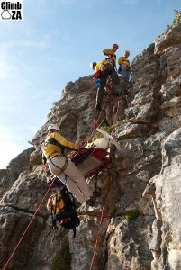 Scenario: Patient fallen down short cliff, sustained head, neck and rib injuries. Hosted up on stretcher using tensioned backrope to assist with keeping the stretcher away from the cliff. The stretcher needed to be turned from horizontal to vertical to get it through the gully at the top of the cliff.