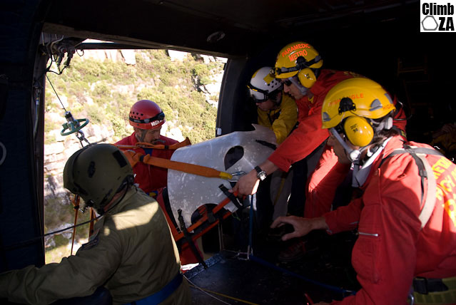 Rescuers bring the stretcher inside the Oryx helicopter while on a mountain rescue training exercise held on the Twelve Apostles side of Table Mountain.