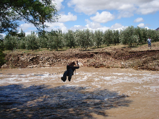 The only people to get over the river on Friday, 7 of our guests had cars on the other side so they wanted to go home. They didn't have to ask twice and I was off like a super keen boy scout and all my kit. The tractor on the other side helped get the rope tension up, I got a wet bum on the two test runs. Loads of fun.