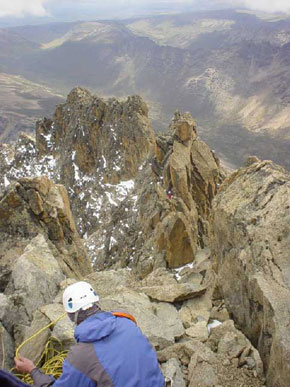Abseiling off the summit of Batian with the summit ridge in front of us