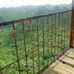 Surveying the jungle from a rickety old communist lookout tower in the middle of the island