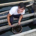 Hai at home on his floating fish farm