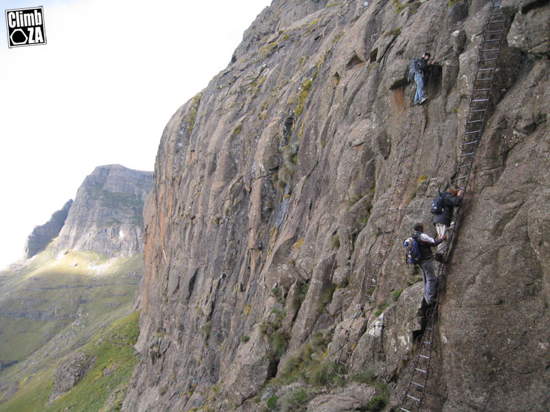 Chain ladders, Mont-Aux-Sources, Drakensberg, guide helps a tourist