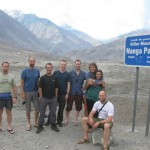 The Trango 2012 team on the Karakoram highway Pakistan.  In the back ground stands Nanga Parbat 8126m (according to the sign).   he team Dobek Pater(trekking), Carter Jensen(USA), Adam Liebenberg, Neil Grimmer (trekking), Douard le Roux, Alard and Shelly Hufner and Robert Powel.