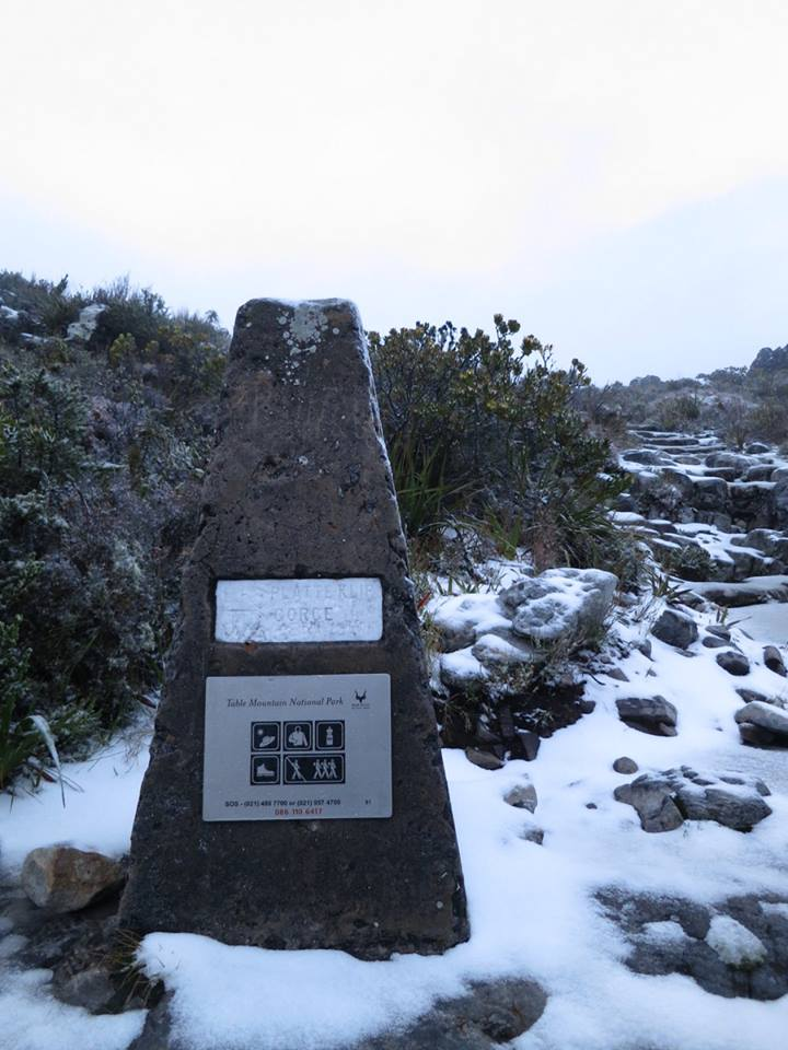 Route marker surrounded by snow. Photo by Mark Jacobson