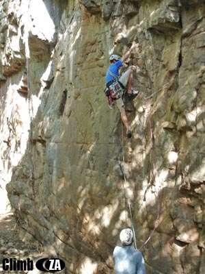 Alan Grant heading up 'Bats Overhang' (16) Trident Kloof, Magaliesberg. . Photo by: Ian