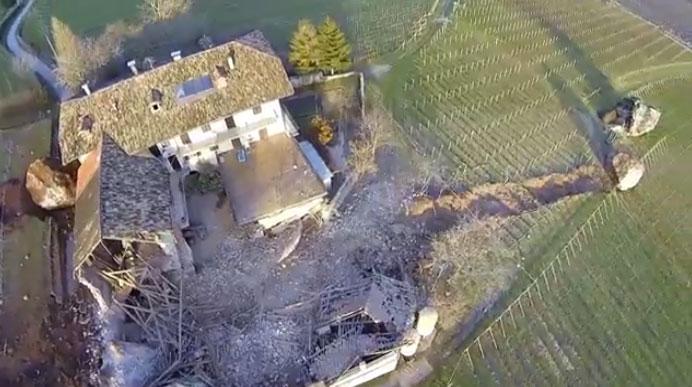 Rockfall boulders destroy house