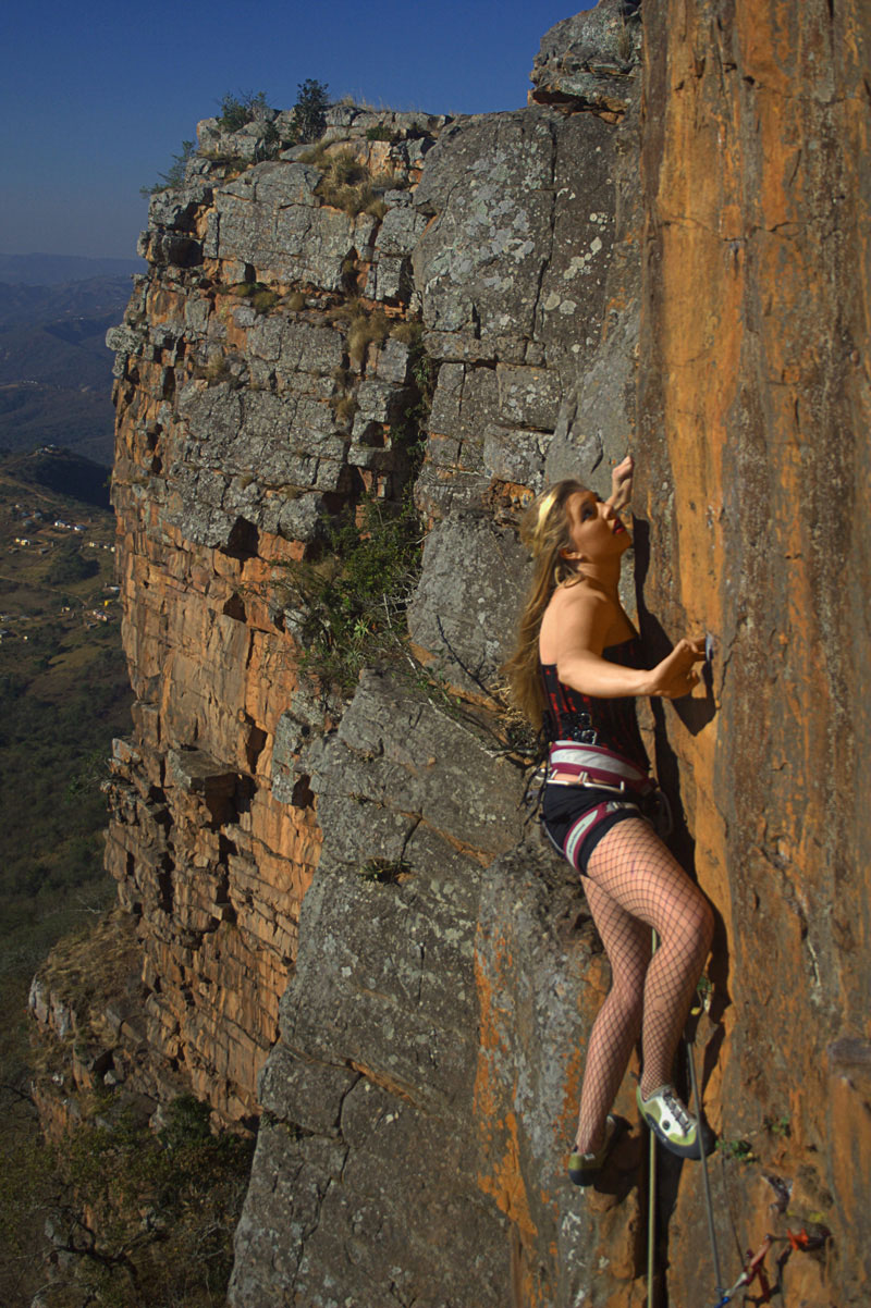 Pin up girl climbing