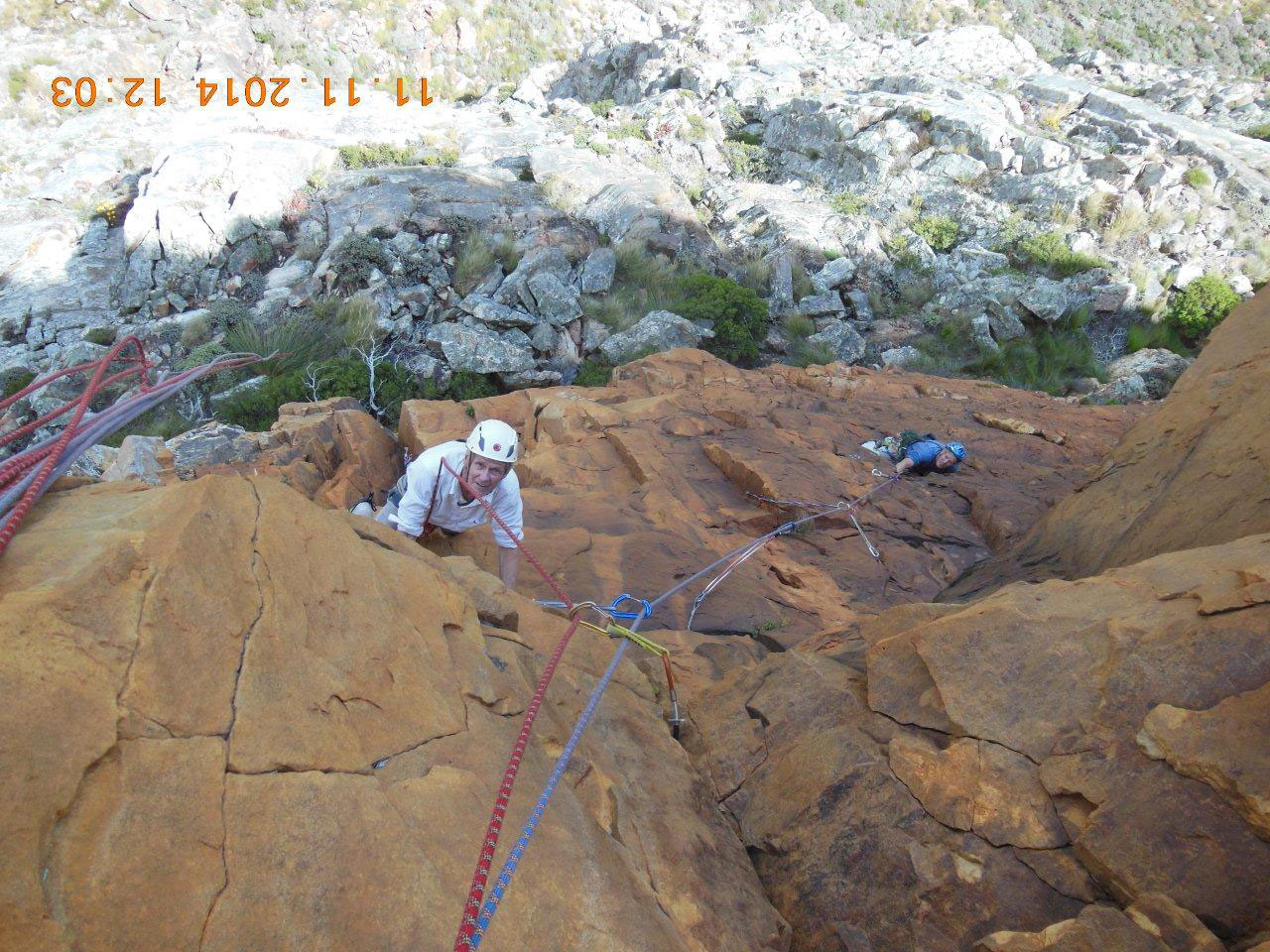 Tony Dick climbing pitch 3 of Masquerade, with Bruce following