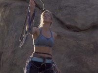 Female climber catch sling