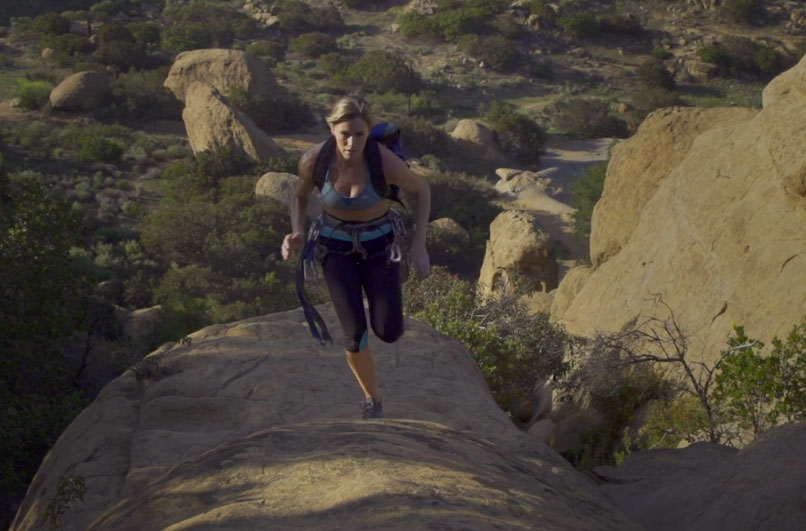 female climber running
