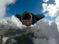 Wingsuit flying clouds