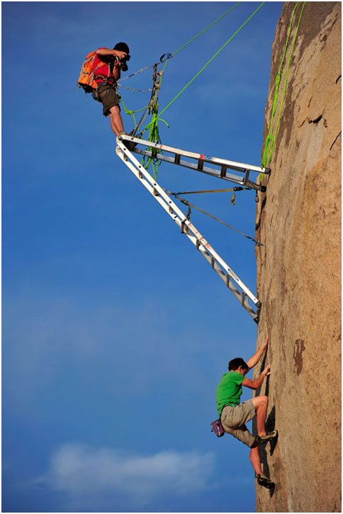 The troubles some people go to for good video or still material. Corey Rich shooting Alex Honnold.