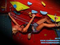Girl climbing on indoor climbing wall