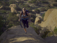 female climber running