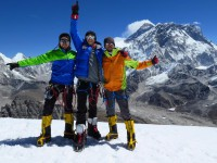 """From Left to Right:  Florian Nagl, Dan Fredinburg and Michele Battelli in Lobuche, Nepal during April 2013 - First Himalayan """"warm-up"""" peak conquered: """"Lobuche East"""" (6119m) - Mt. Everest in the background."""