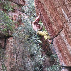 Setting up for the crux of Fear and Loathing (7c+ trad) — Photo by Ockert Joubert