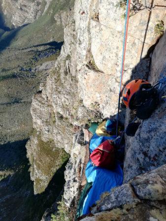 Sleeping on rock ledge